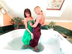 Girls in incomparable dresses have a bath together